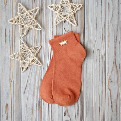 носки оранжевые короткие наклейка